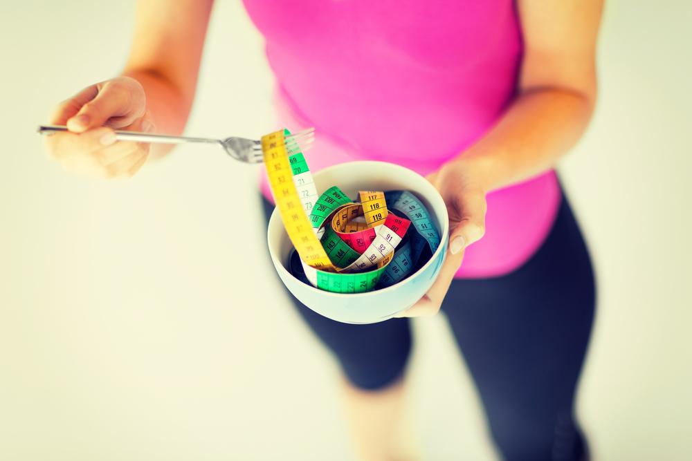Gewicht verliezen: minder eten of harder trainen?